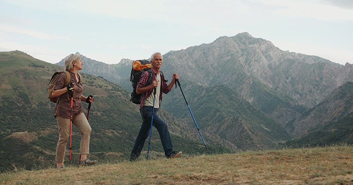 a mature couple hiking in the mountains